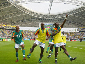 (From L-R) Senegal's forward El Hadji Diouf, forward Amara Traore and defender Ferdinand Coly celebrate after Senegal qualified for the quarterfinals with a 2-1 victory over Sweden in overtime of match 51 round of 16 of the 2002 FIFA World Cup Korea Japan 16 June, 2002 in Oita, Japan. AFP PHOTO PATRICK HERTZOG
