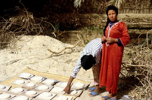 Egyptian Woman Prepares Bread
