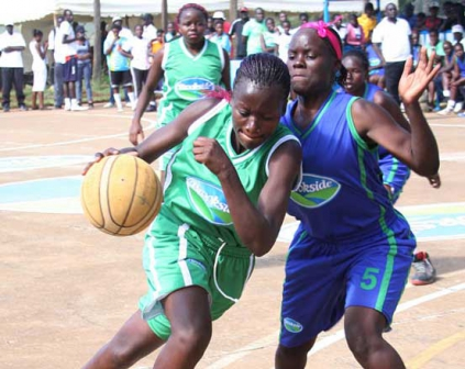 High school girls competing in basketball