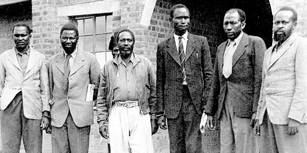 Jomo Kenyatta (3rd left) and five others charged of being Mau-Mau leaders