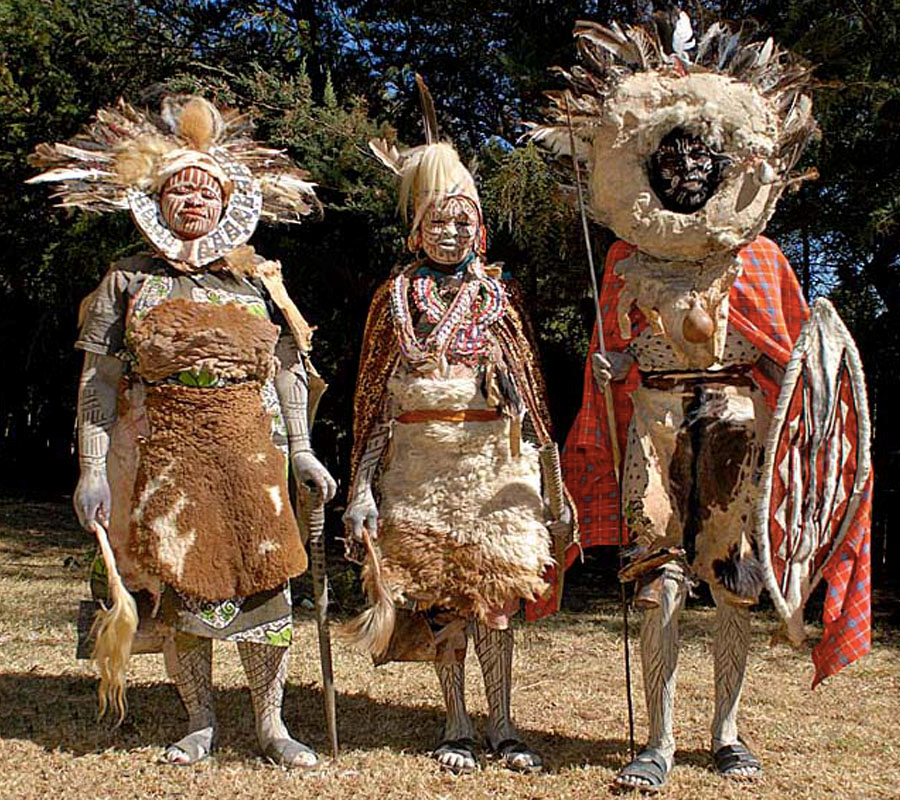 Kikiyu dancers wearing traditional costumes